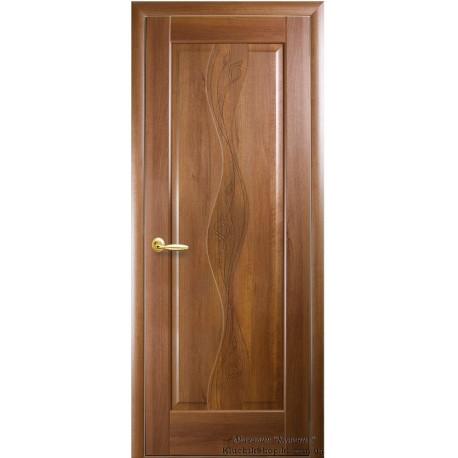 Двері Волна / Суцільні з гравіюванням / Декор вільха золота